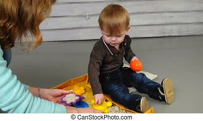 Little boy playing on the floor.
