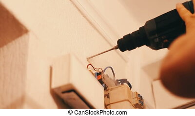 A man drills wall with electric drill - Drill machine...