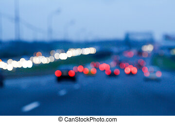 Background of bokeh lights at night on road with cars