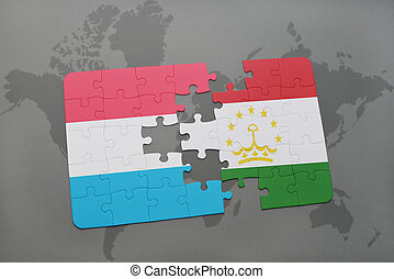 puzzle with the national flag of luxembourg and tajikistan...