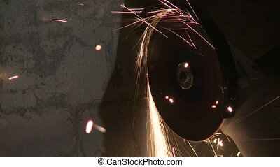 Process of cutting metal with sparks