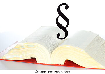 black paragraph symbol on an opened book