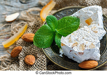 Almond nougat with candied fruit and mint. - Almond nougat...