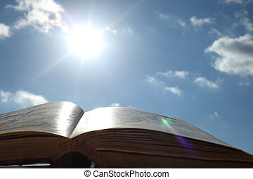 book of wisdom -  book of wisdom on sun sky background