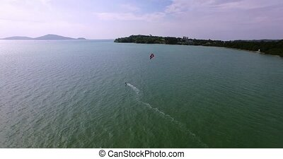 Aerial view kite surfing in tropical blue ocean 4K - Aerial...
