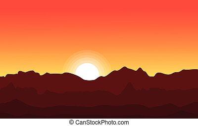 At sunset desert landscape silhouette