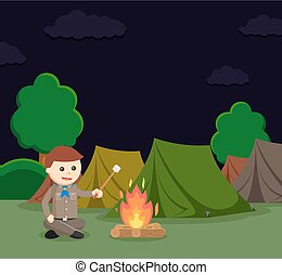 boy scout roasting marshmallow at camping site