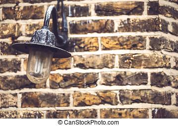 Textured brick wall with lantern