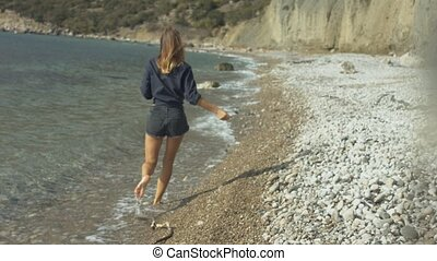 Beautiful girl walking on the beach - Beautiful girl walking...