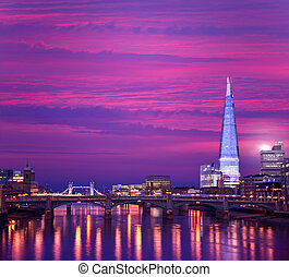London skyline sunset on Thames river reflection at UK