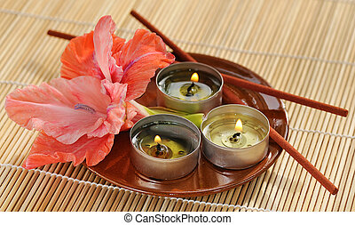 aromatherapy - scened burn candles with gladiolus and...