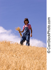 Finding a hanful of wheat stalks.