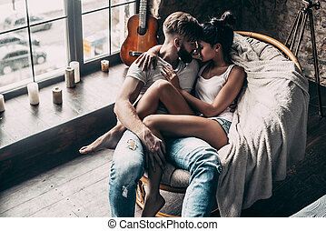 One and only. Top view of beautiful young couple embracing...