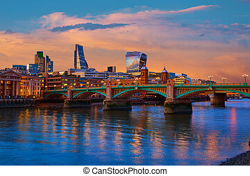 London skyline sunset Southwark bridge UK - London skyline...
