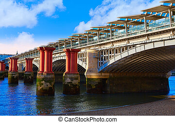 London Blackfriars Train bridge in Thames river UK