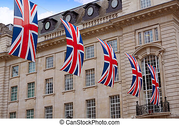 London UK flags in Piccadilly Circus England