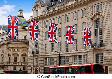 London Bus and UK flags in Piccadilly Circus England