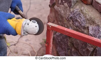 Removing rust grinder - Master removes rust from metal...