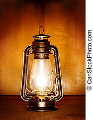 oil lamp - old oil lamp light over wood plank background