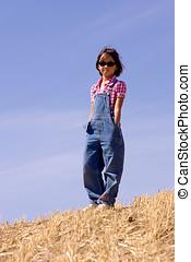 Farmer girl in field.