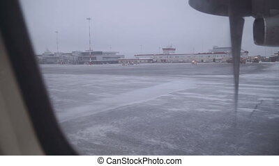 view from the window of an airplane runway, winter. slow motion from 50 fps Full HD