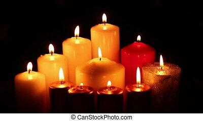 many lit candles quickly extinguished - Many different...