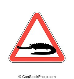 Attention crocodile. Alligator on red triangle. Road sign...