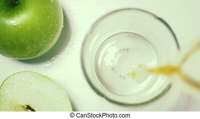 Apples green top view slow motion poured juice