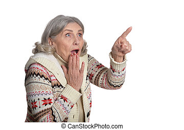 mature woman making facial expression against white...