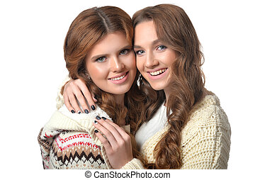 two beautiful young women close up portrait