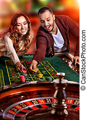 Ypung couple in casino