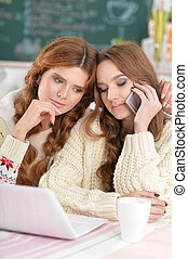 two beautiful young women - Portrait of two beautiful young...