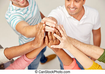 international group of people making high five - diversity,...