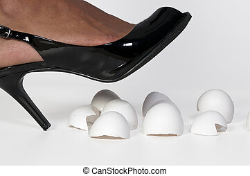 Walking on Eggshells - A woman in high heels walking on...