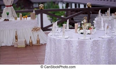 Decorated wedding table on a green lawn.