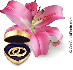 Wedding rings and pink lily