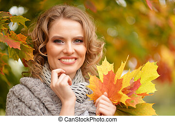beautiful woman portrait posing outdoors in autumn with...