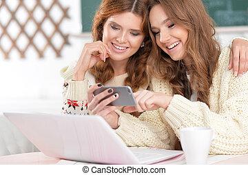 two beautiful young women - Portrait of a two beautiful...