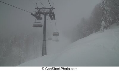 Chairlift for 4 persons in the clouds Rosa Khutor Alpine Resort stock footage video