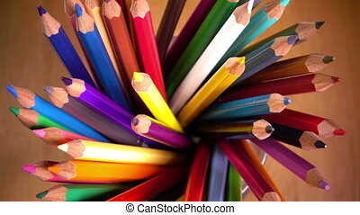 the mug with bright pencils turns.slow motion,