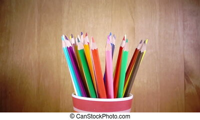 the mug with bright pencils turns.slow motion