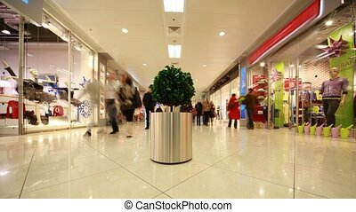 People in modern shopping centre