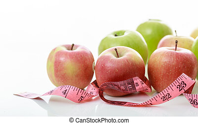 Apples and measure tape on white background