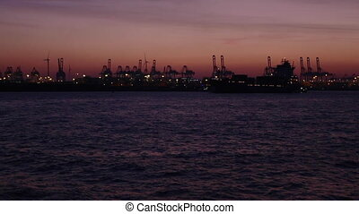 Container ship at port of Hamburg at night