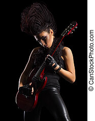 Young woman hard rock musician isolated