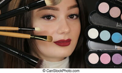 Woman with makeup brushes and eyeshadow - Beautiful woman...