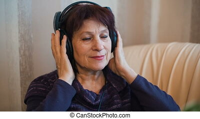 Elderly woman in Headphones