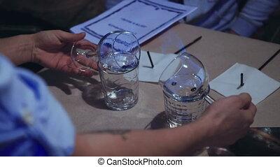 The bartender prepares Sambuca at the bar slow motion from...