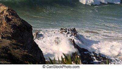 Huge Ocean Waves Breaking Against Rocks, Algarve, Portugal