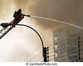 Fireman putting out a fire - Burning down of 20 commercial...